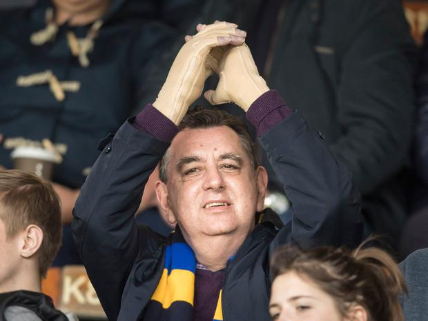 Chris King, the UK's first double hand transplant patient, applauds the Leeds Rhinos rugby league team on to the pitch at Headingley Carnegie stadium in Leeds ahead of their Super League match against Widnes Vikings. PA