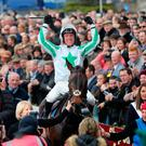 Our Duke ridden by Robbie Power celebrate winning the Boylesports Irish Grand National Chase during the Easter Festival at Fairyhouse Racecourse, Co. Meath, Ireland. PA