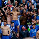 Brighton and Hove Albion players and fans celebrate promotion following the Sky Bet Championship match at the AMEX Stadium, Brighton. PA
