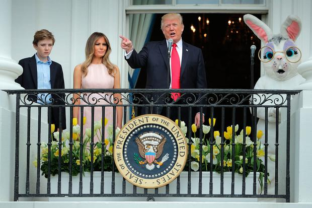 article news melania trump nudges donald during white house easter roll