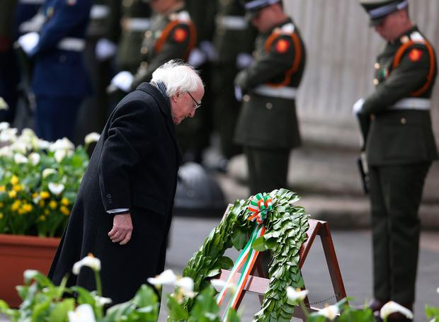 President of Ireland Michael D. Higgins lays a wreath during a ceremony to mark the 101st anniversary of the 1916 Easter Rising outside the GPO, in O'Connell Street, Dublin. PA