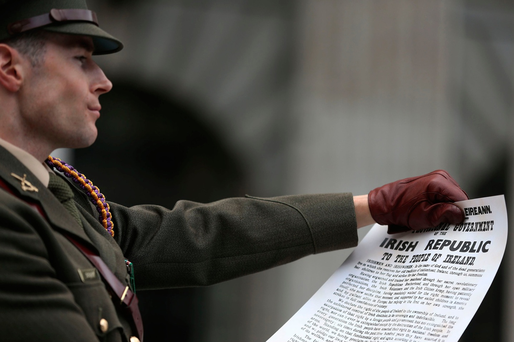 Captain Michael Barry of the Irish Defence Forces holds a copy of the Proclamation during a ceremony to mark the 101st anniversary of the 1916 Easter Rising outside the GPO, in O'Connell Street, Dublin. PA