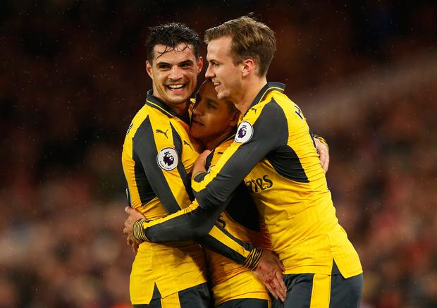 Alexis Sanchez of Arsenal (7) celebrates as he scores their first goal with Granit Xhaka (L) and Rob Holding (R) during the Premier League match between Middlesbrough and Arsenal at Riverside Stadium on April 17, 2017 in Middlesbrough, England. (Photo by Jan Kruger/Getty Images)