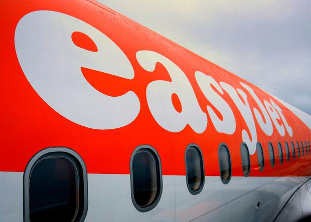Two easyJet passengers were ordered to leave an overbooked flight and told they would have to wait four days before they could travel again. PA