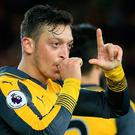 Arsenal's German midfielder Mesut Ozil gestures as he celebrates scoring his team's second goal during the English Premier League football match between Middlesbrough and Arsenal at Riverside Stadium in Middlesbrough, northeast England on April 17, 2017. AFP/Getty Images