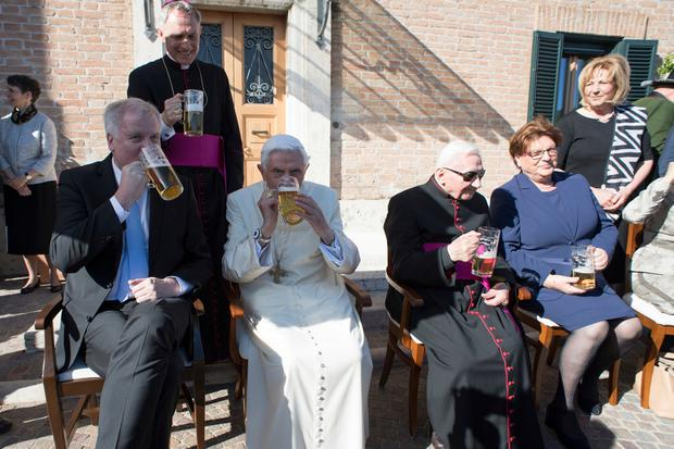 From left, Bavarian Prime Minister Horst Seehofer, Pope Emeritus Benedict XVI and his brother Georg have a glass of beer on the occasion of a party for Benedict's 90th birthday, at the Vatican Monday, April 17, 2017. (L'Osservatore Romano/Pool Photo via AP)