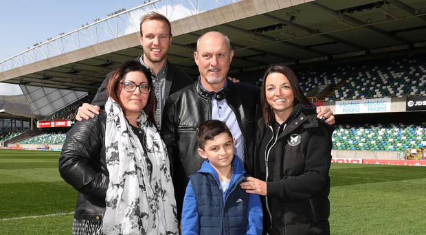 Jimmy Quinn at Windsor Park with his eldest son Lewis, daughters Julie and Samantha and his youngest son Alex
