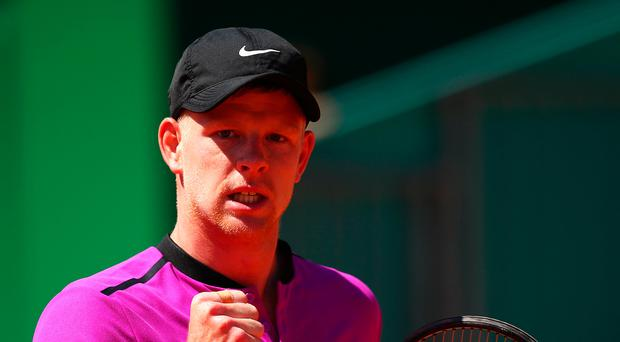 Ace in pack: Kyle Edmund sees off Dan Evans yesterday
