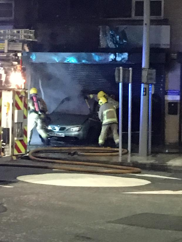 Firefighters at the scene of the blaze in Main Street, Larne last night
