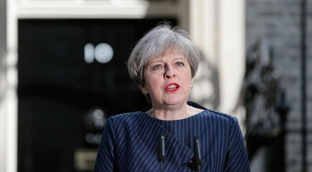 British Prime Minister Theresa May speaks to the media outside 10 Downing Street in central London on April 18, 2017. British Prime Minister Theresa May has called for an early general election. / AFP PHOTO / Daniel LEAL-OLIVASDANIEL LEAL-OLIVAS/AFP/Getty Images