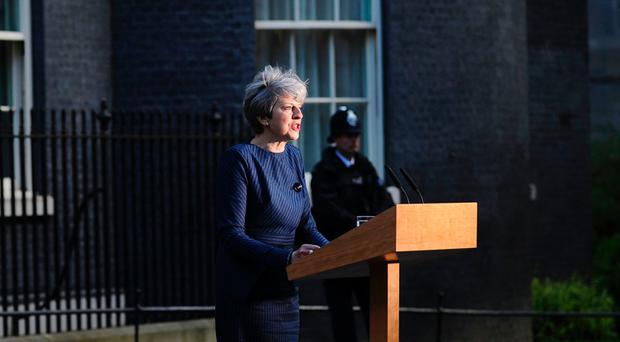 Prime Minister Theresa May speaks to the media outside 10 Downing Street in central London on April 18, 2017.