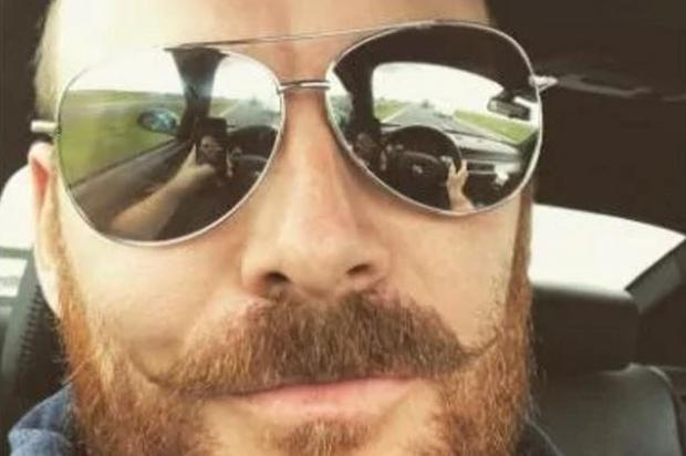 The steering wheel and road can be seen in the reflection of this man's Aviators in his selfie. Credit: Northumbria Police