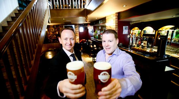 Gavin Weir, Director, GVA NI and Gavin Bates, Owner, the White Horse Coaching Inn, toast their partnership as the deal is made final on the 200 year old bar and restaurant located in Saintfield