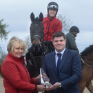 Jess brilliant: Jessica Harrington receives the Phillips Sports monthly award from Dave Murphy, of Phillips Lighting. Also included is Kate Harrington on Cheltenham Gold Cup winner Sizing John. Photo: Adrian Melia