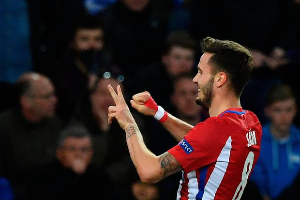 Atletico Madrid's Spanish midfielder Saul Niguez celebrates scoring his team's first goal during the UEFA Champions League quarter-final second leg football match between Leicester City and Club Atletico de Madrid at the King Power stadium in Leicester on April 18, 2017. AFP/Getty Images