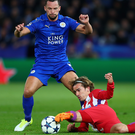 Stretch: Drinkwater tangles with Griezmann. Photo: Clive Rose/Getty Images