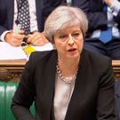 Prime Minister Theresa May speaks during Prime Minister's Questions in the House of Commons, London. PA Wire