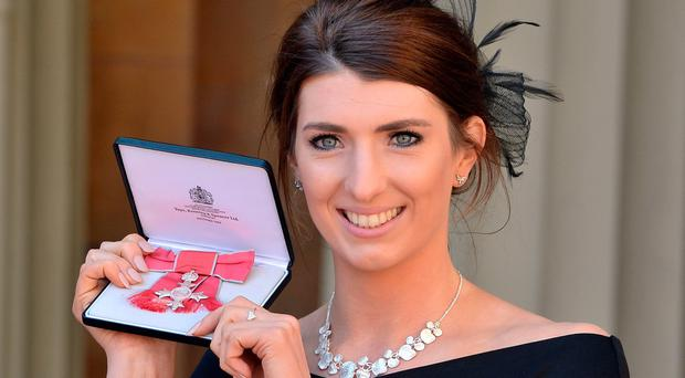 Swimmer Bethany Firth after she was awarded an MBE by the Duke of Cambridge during an investiture ceremony at Buckingham Palace in London. John Stillwell/PA Wire