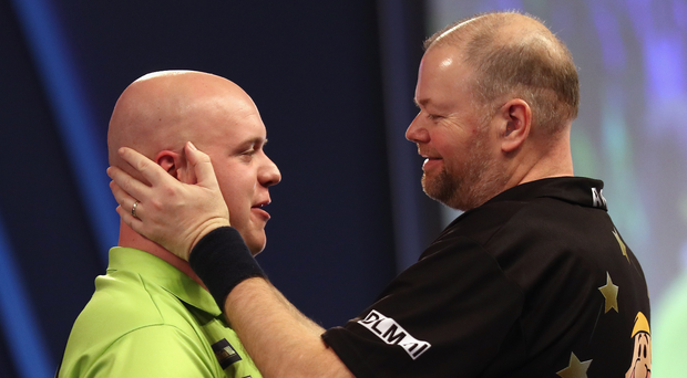 Class acts: Raymond van Barneveld (right) and Michael van Gerwen clash at the SSE Arena tonight. Photo: Bryn Lennon/Getty Images