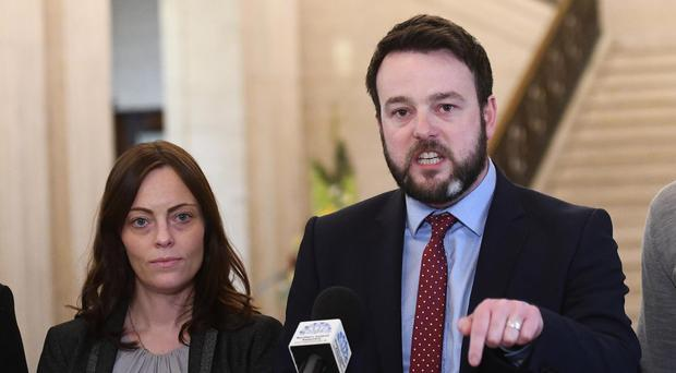 Colum Eastwood with colleague Nichola Mallon at Stormont yesterday