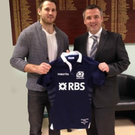 Star pupil: Tommy Seymour presents one of his Scotland shirts to vice-principal Gareth McKillen at Down High