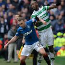 Tough battle: Moussa Dembele, pictured in a duel with Northern Ireland and Rangers ace Lee Hodson, says Celtic need to be at 100 per cent