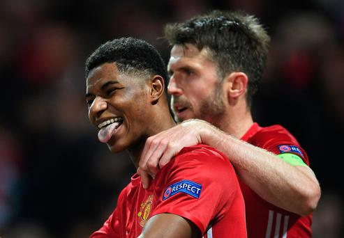 Marcus Rashford of Manchester United celebrates with team mate Michael Carrick as he scores their second goal during the UEFA Europa League quarter final second leg match between Manchester United and RSC Anderlecht at Old Trafford on April 20, 2017 in Manchester, United Kingdom. (Photo by Laurence Griffiths/Getty Images)