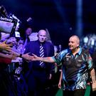 Legend: Phil Taylor makes his entrance at the SSE Arena