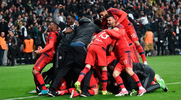 Spot-kick joy: Lyon celebrate their penalty shoot-out victory over Besiktas last night
