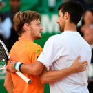 Heading home: Novak Djokovic congratulates his conqueror David Goffin after the Serb's early exit in Monte Carlo