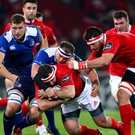Battle: Leinster's Rhys Ruddock tackles Munster's James Cronin, with both teams in with a chance of Euro progress this weekend