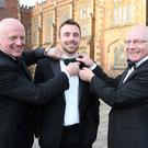 Bowe tie: Tommy Bowe (centre) fitted up by Queen's rugby alumni and former Ireland internationals Philip Matthews and Nigel Carr ahead of last night's legends dinner
