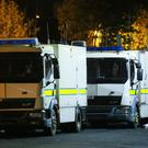 Police at the scene of an overnight security alert in the Herbert Street area of Ardoyne.