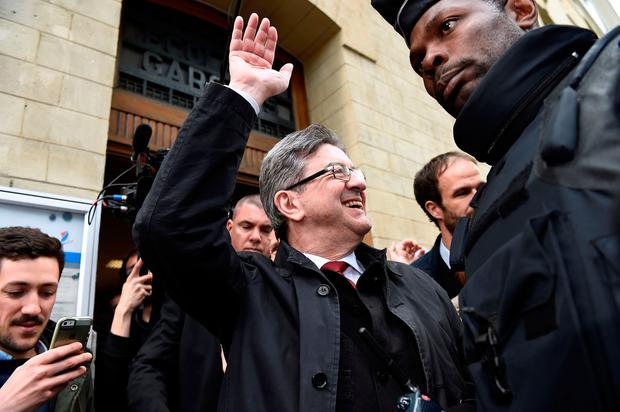 French presidential election candidate for the far-left coalition La France Insoumise Jean-Luc Melenchon waves as he leaves a polling station in Paris, on April 23, 2017, during the first round of the Presidential election. / AFP PHOTO / bertrand GUAYBERTRAND GUAY/AFP/Getty Images