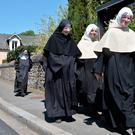 Benedictine sisters of the Sainte-Cecile Abbey arrive to vote at a polling station in Solesmes, northwestern France, during the first round of the French presidential election. / AFP PHOTO / JEAN-FRANCOIS MONIERJEAN-FRANCOIS MONIER/AFP/Getty Images