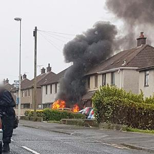 A fire following an incident when a car hit the front of a house in Larne