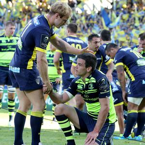 Over and out: Leinster's Johnny Sexton is consoled by Nick Abendanon of Clermont