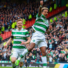 Up and away: Scott Sinclair jumps for joy after doubling Celtic's advantage from the penalty spot
