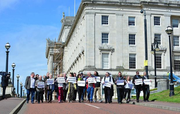 Institutional child abuse victims have marched at Stormont to demand justice. Pic: Arthur Allison Pacemaker.
