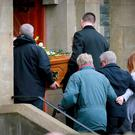 The family of James Campbell follow his coffin into church at his funeral yesterday