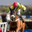 Powering ahead: Fox Norton, with jockey Robbie Power in the saddle, clinches Boylesports Champion Chase glory at Punchestown ahead of Un De Sceaux