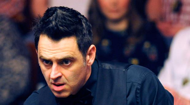 Struggling: Ronnie O'Sullivan lines up a shot last night at the Crucible