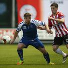 Up close: Derry's Ben Doherty (right) and Limerick's Chris Mulhall battle it out at Maginn Park last night