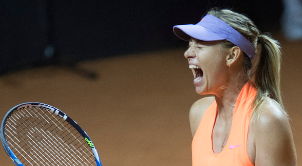 Making a racket: Maria Sharapova celebrates victory over Roberta Vinci in Stuttgart last night in her first match back after a 15-month doping ban