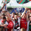 Glory days: Paul Leeman lifts the Gibson Cup after Glentoran's final-day victory in 2009, the last time the east Belfast men won the league