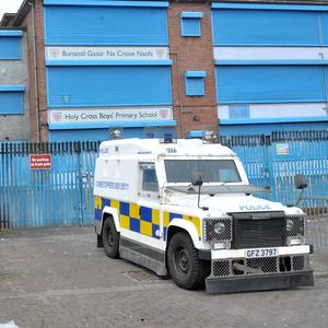 Police outside Holy Cross Boys Primary School on Sunday, where a bomb left by