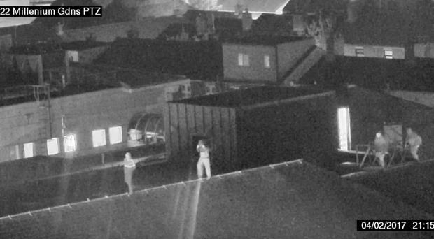 CCTV of young people walking on roof of Royal Victoria Hospital