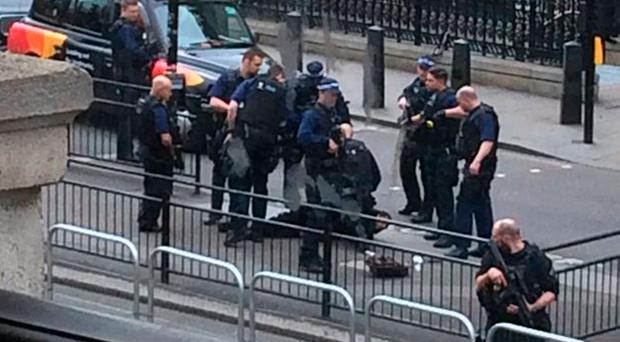 Photo with permission from the Twitter feed of @joshdcaplan of Police at the scene where a man has been arrested following an incident in Whitehall in London. @joshdcaplan/PA Wire
