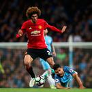 Marouane Fellaini of Manchester United fouls Sergio Aguero of Manchester City in the build up to Marouane Fellaini being shown a red card during the Premier League match between Manchester City and Manchester United at Etihad Stadium on April 27, 2017 in Manchester, England. (Photo by Clive Brunskill/Getty Images)