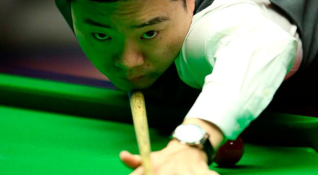 On target: Ding Junhui on his way to a 5-3 lead over Mark Selby